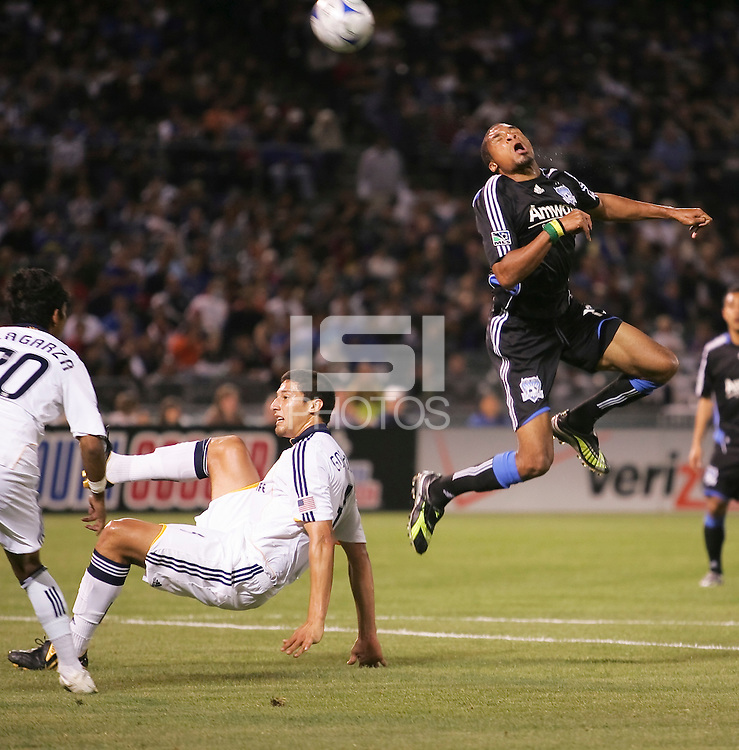 Ryan Johnson (right) heads the ball over Omar Gonzalez (left). San Jose Earthquakes tied Los Angeles Galaxy 1-1 at the McAfee Colisum in Oakland, California on April 18, 2009.