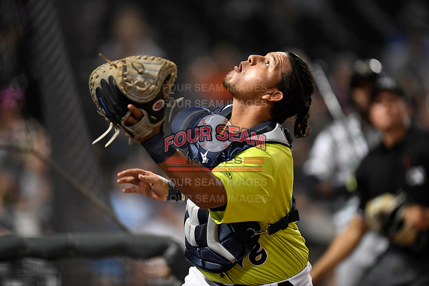 Catcher Natanael Ramos (16) of the Columbia Fireflies tracks down and catches a pop up near the visitors' dugout in a game against the Augusta GreenJackets on Saturday, July 29, 2017, at Spirit Communications Park in Columbia, South Carolina. Columbia won, 3-0. (Tom Priddy/Four Seam Images)