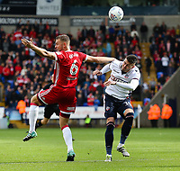 Middlesbrough's Ben Gibson vies for possession with Bolton Wanderers' Gary Madine<br /> <br /> Photographer Juel Miah/CameraSport<br /> <br /> The EFL Sky Bet Championship - Bolton Wanderers v Middlesbrough - Saturday 9th September 2017 - Macron Stadium - Bolton<br /> <br /> World Copyright &copy; 2017 CameraSport. All rights reserved. 43 Linden Ave. Countesthorpe. Leicester. England. LE8 5PG - Tel: +44 (0) 116 277 4147 - admin@camerasport.com - www.camerasport.com