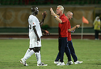 The United States' coach Thomas Rongen congratulates Gale Agbossoumonde (2) and Ike Poara (16) after their victory over  Cameroon 4-1 at the FIFA Under 20 World Cup Group C Match between the United States and Cameroon at the Mubarak Stadium on September 29, 2009 in Suez, Egypt.