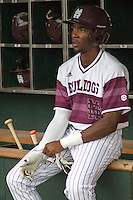 Mississippi State outfielder Demarcus Henderson (2) in the dugout before Game 11 of the 2013 Men's College World Series against the Oregon State Beavers on June 21, 2013 at TD Ameritrade Park in Omaha, Nebraska. The Bulldogs defeated the Beavers 4-1, to reach the CWS Final and eliminating Oregon State from the tournament. (Andrew Woolley/Four Seam Images)