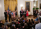 """United States President Donald J. Trump makes remarks prior to signing an executive order that will require colleges that receive federal research grant money to certify that they """"promote free inquiry"""" in the East Room of the White House in Washington, DC on Thursday, March 21, 2019.<br /> Credit: Ron Sachs / CNP"""