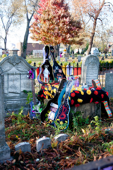 Gravestones decorated for the Day of the Dead ceremony with flowers and pictures at the Day of the Dead Ceremony in Downtown Lexington, Ky., on Thursday, November 1, 2012..
