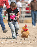 Kloe Abbott, 5, competes in a chicken race at the 56th annual International Camel &amp; Ostrich Races in Virginia City, Nev. on Friday, Sept. 11, 2015. <br /> Photo by Cathleen Allison