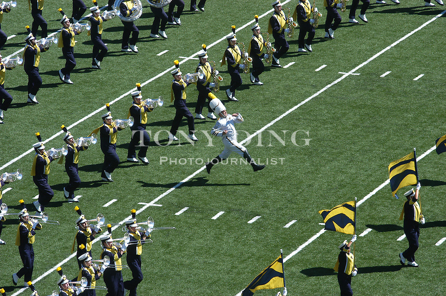 Engineering Senior Matt Cavanaugh leads the Michigan Marching band at the beginning of the Wolverine's 50-3 blowout of Houston on Saturday, September 6, 2003 at Michigan Stadium in Ann Arbor, Mich (TONY DING/The Michigan Daily).