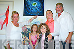 Rebecca Carroll Asdee shows her family her painting My Siblings Gather at the Gathering Art exhibition in the Department of Arts, Tourism and the Gaelteacht on Monday evening l-r: Ellen, Oscar, David Griffin with her friend Sonia Broderick