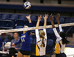 Marymount's Emileigh Rettig dinks against St. Mary's during a college volleyball game in Lexington Park, MD, on Wednesday, Oct. 29, 2014. Marymount won 3-2 to go 24-9 on the season.<br /> Photo by Cathleen Allison