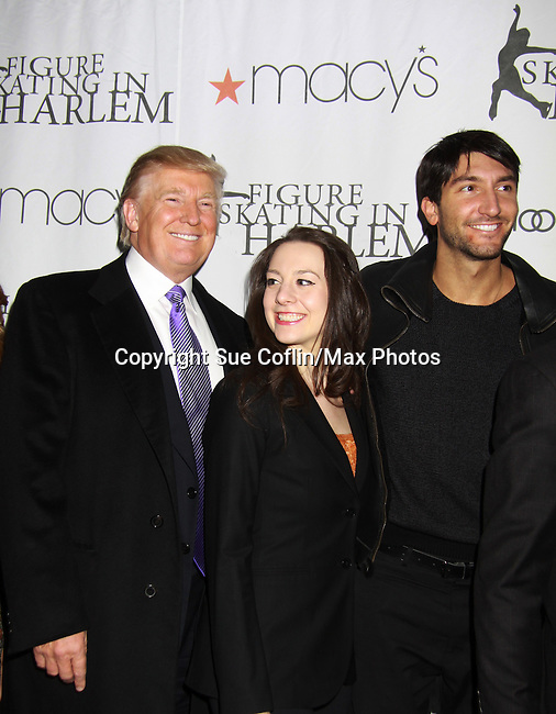 Donald Trump, Sarah Hughes and Evan Lysecek at the 2012 Skating with the Stars - a benefit gala for Figure Skating in Harlem celebrating 15 years on April 2, 2012 at Central Park's Wollman Rink, New York City, New York.  (Photo by Sue Coflin/Max Photos)