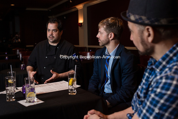 WATERBURY, CT- 31 May 2016-053116EC07-  Executive Chef Kevin Tynan Smith talks about the new menu with 92 Bank co-owners Chris Cobb Olsen and Joshua Michael Angelus. The new restaurant and bar just opened along Bank Street in downtown Waterbury. The two-level space is also a cabaret, with performance space upstairs called Club 92. Erin Covey Republican-American