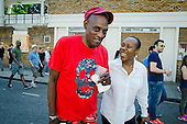 Darcus Howe, writer, broadcaster and social commentator, with Claire Holder, a past CEO of the Notting Hill Carnival Trust, Notting Hill Carnival 2013..