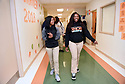 Domonique Crosby and her best friend Terr'nique Delair walk together after class at George Washington Carver High School.