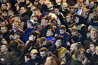 Lincoln City fans watch their team in action<br /> <br /> Photographer Chris Vaughan/CameraSport<br /> <br /> The EFL Sky Bet League Two - Lincoln City v Cheltenham Town - Tuesday 13th February 2018 - Sincil Bank - Lincoln<br /> <br /> World Copyright &copy; 2018 CameraSport. All rights reserved. 43 Linden Ave. Countesthorpe. Leicester. England. LE8 5PG - Tel: +44 (0) 116 277 4147 - admin@camerasport.com - www.camerasport.com