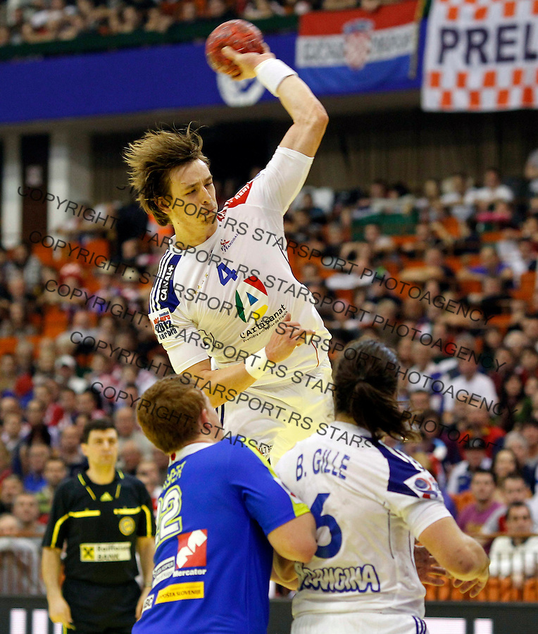 Xavier Barachet of France scores during main round, group 2 men`s EHF EURO 2012 championship handball game between France  and Slovenia in Novi Sad, Serbia, Sunday, January 21, 2011.  (photo: Pedja Milosavljevic / thepedja@gmail.com / +381641260959)