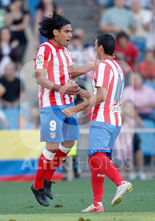 Atletico de Madrid's Jose Antonio Reyes celebrates with Radamel Falcao during La Liga Match. September 18, 2011. (ALTERPHOTOS/Alvaro Hernandez)