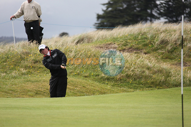 Rory McElroy playing the14th after play restarted on day 3 at the 3 Irish open in Co Louth Golf Club...Photo: Fran Caffrey/www.golffile.ie..