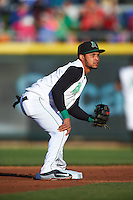 Dayton Dragons second baseman Ronald Bueno (4) waits for a throw in warmups between innings during a game against the Great Lakes Loons on May 21, 2015 at Fifth Third Field in Dayton, Ohio.  Great Lakes defeated Dayton 4-3.  (Mike Janes/Four Seam Images)