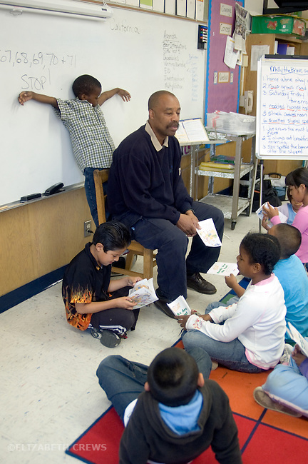 Oakland CA 2nd grade teacher conducting calm lesson while out-of-control student acts out behind his back  MR
