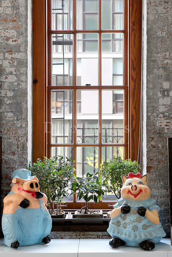 statuettes in front of the window