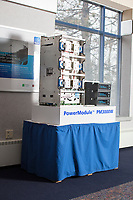 A PowerModule PM3000W is visible in a conference room in the old headquarters of American Superconductor, also known as AMSC, an energy technology company now based in Ayer, Massachusetts. This image is from the old headquarters in Devens, Massachusetts, USA, seen on Tues., Jan. 30, 2018. The PM3000W is the same type of electronic control system used in wind turbines that was at the center of a trade secret theft by Chinese company Sinovel. AMSC manufacturers electronic control systems for wind turbines such as this one. AMSC was the victim of the theft of trade secrets, starting in 2011 when the Chinese company Sinovel worked to steal and modify AMSC's proprietary wind turbine-running software. Sinovel was AMSC's largest customer, and McGahn estimates that 70% of China's wind turbines now run software stolen from AMSC. AMSC has received favorable judgments from American and Chinese courts, and the company contends that it is owed billions of dollars as a result of the theft, which almost destroyed the company. When news of the theft came out, the company's stock value decreased substantially and went from approximately 800 employees to fewer than 200. The company has rebounded some since the crime.