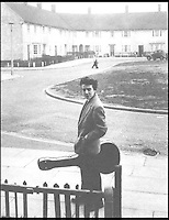 BNPS.co.uk (01202 558833)<br /> Pic: HomesBoughtFast/BNPS<br /> <br /> ***Use full Byline***<br /> <br /> George Harrison outside his house.<br /> <br /> Money can't buy you love... but it can buy you the childhood home of Beatles star George Harrison which has gone on the market for a mystery sum.<br /> <br /> The humble three-bed terrace was home to Harrison and his family in the 1950s and was where he and his friends Paul McCartney and John Lennon held their first band rehearsals.<br /> <br /> Harrison lived at the property, on a housing estate in Liverpool, until the early 1960s when the Beatles rocketed to international superstardom.<br /> <br /> The historic home has now been put up for auction - but its sellers are remaining tight-lipped about how much they expect it to fetch.<br /> <br /> It comes just a year after John Lennon's unassuming childhood home in Liverpool was snapped up at auction by a Beatles fan for 480,000 pounds - three times the initial 150,000 pounds estimate.
