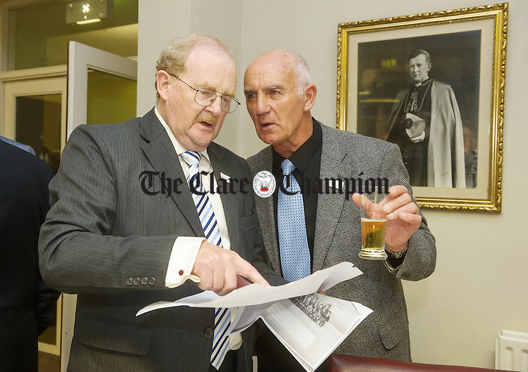 Paul Barrett and James O Loughlin catch up at the 50th reunion of the St Flannan's College 1966  Leaving Cert class. Photograph by John Kelly.