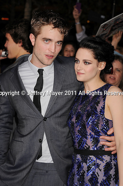 "LOS ANGELES, CA - NOVEMBER 14: Robert Pattinson and Kristen Stewart arrive at the Los Angeles premiere of ""The Twilight Saga: Breaking Dawn Part 1"" held at Nokia Theatre L.A. Live on November 14, 2011 in Los Angeles, California."