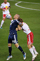 Eric Hassli (29) of the Vancouver Whitecaps is defended by Chris Albright (3) of the New York Red Bulls. The New York Red Bulls  and the Vancouver Whitecaps played to a 1-1 tie during a Major League Soccer (MLS) match at Red Bull Arena in Harrison, NJ, on September 10, 2011.
