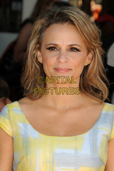 Amy Sedaris.The L.A. Premiere of 'Puss in Boots' held at The Regency Village Theatre in Westwood, California, USA..October 23rd, 2011.headshot portrait yellow white grey gray  .CAP/ADM/BP.©Byron Purvis/AdMedia/Capital Pictures.