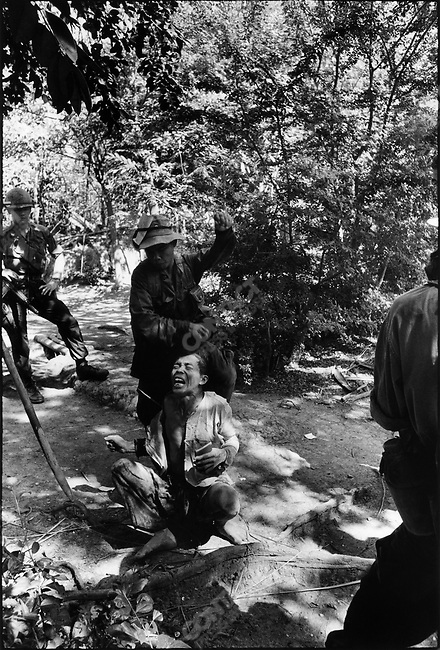 The Vietnam War, South Vietnamese soldiers, with their American advisor, interrogate a villager suspected of sympathizing with the Vietcong, Mekong Delta, South Vietnam, December 1967