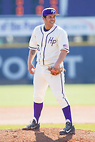 High Point Panthers starting pitcher Andre Scrubb (16) looks to his catcher for the sign against the Bowling Green Falcons at Willard Stadium on March 9, 2014 in High Point, North Carolina.  The Falcons defeated the Panthers 7-4.  (Brian Westerholt/Four Seam Images)