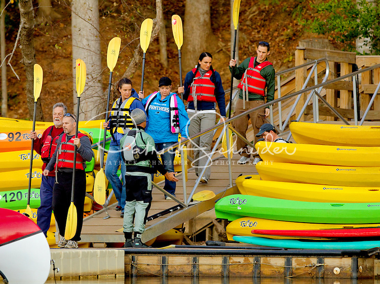 Visitors (these are models) carry kayaks down to the Catawba River as they participate in a Micro Brews Cruise outing at the US National Whitewater Center in Charlotte, NC. The USNWC, an ultimate adventure playground for outdoor enthusiasts, offers both water and land sports. Micro Brews Cruise offers flatwater kayaking, fireside dinner and craft beer tastings on select nights.