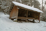 Appalachian Trail - Ethan Pond Shelter is an Adirondack style shelter located just off the Ethan Pond Trail in the White Mountains of New Hampshire USA. Blowing snow cam be seen in the scene.