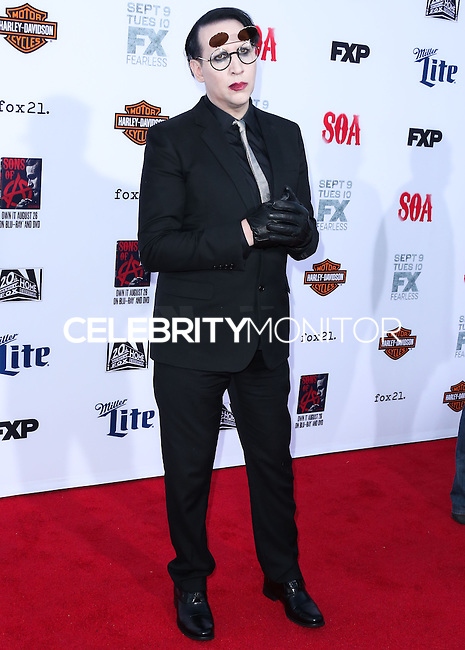 HOLLYWOOD, LOS ANGELES, CA, USA - SEPTEMBER 06: Musician Marilyn Manson arrives at the Los Angeles Premiere Of FX's 'Sons Of Anarchy' Season 7 held at the TCL Chinese Theatre on September 6, 2014 in Hollywood, Los Angeles, California, United States. (Photo by Xavier Collin/Celebrity Monitor)