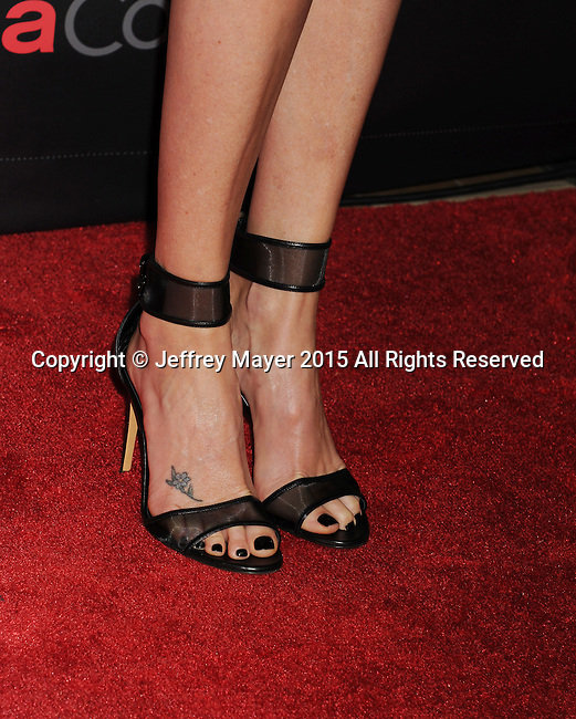 "LAS VEGAS, CA - APRIL 21:  Actress Charlize Theron, shoe, tattoo detail, at Warner Bros. Pictures Invites You to ""The Big Picture at The Colosseum at Caesars Palace during CinemaCon, the official convention of the National Association of Theatre Owners, on April 21, 2015 in Las Vegas, Nevada."