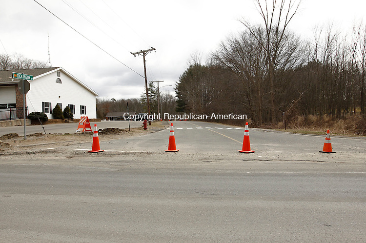 Newtown, CT- 28 March 2013-032813CM05-  Dickinson Dr. a road that leads to Sandy Hook Elementary School, remains blocked Thursday afternoon in Newtown.  Authorities released five search-and-seizure warrants associated with the Sandy Hook shooting that killed 20 children and six adults.  Christopher Massa Republican-American