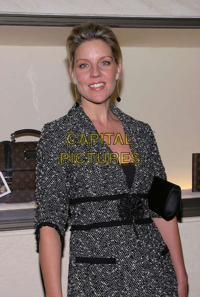 ANDREA PARKER.Louis Vuitton Cocktail Party Benefiting Project Angel Food at the Louis Vuitton Rodeo Drive Store, Hollywood, California, USA, 6th October 2004..half length grey jacket dress .Ref: ADM.www.capitalpictures.com.sales@capitalpictures.com.©JW/AdMedia/Capital Pictures .