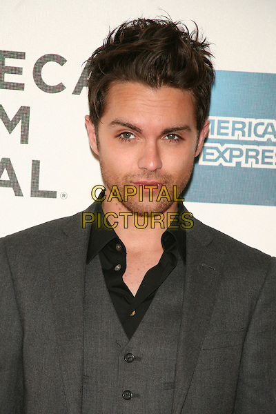 "THOMAS DEKKER .attends the 10th Anniversary Edition of the Tribeca Film Festival - World Premiere of ""Angels Crest"" at the Tribeca Performing Arts Center, New York, NY, USA, April 22nd, 2011..portrait headshot grey gray suit waistcoat black shirt   beard facial hair stubble .CAP/LNC/TOM.©LNC/Capital Pictures."
