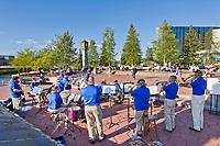 Fairbanks Community Band plays for spectators in the Golden Heart Plaza in downtown Fairbanks, Alaska.