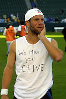 Team captain Jeff Agoos reflects after winning his 5th MLS Cup.  The message on his shirt is a tribute to the recently deceased U of Portland and US Soccer coach Clive Charles.  The San Jose Earthquakes defeated the Chicago Fire 4-2 in  in the MLS Championship at The Home Depot Center on November 23, 2003.