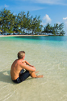 Honduras, Roatan Island, Fantasy Island Resort, Caribbean. Man at the ocean (Robin).