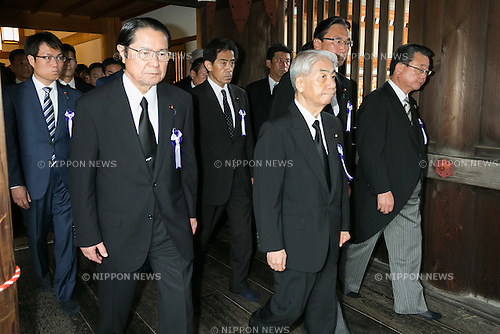 A group of lawmakers, including Hidehisa Otsuji (center), a former health minister, visit Yasukuni Shrine to pay their respects to the war dead on the 71st anniversary of Japan's surrender in World War II on August 15, 2016, Tokyo, Japan. Some 70 lawmakers visited the Shrine to pay their respects, but the Prime Minister Shinzo Abe did not visit the controversial symbol and instead sent a ritual offering to a shrine. Yasukuni enshrines the war dead including war criminals and as such visits by Japanese  politicians tend to provoke anger from neighbors China and Korea that suffered from Japan's militarist past. (Photo by Rodrigo Reyes Marin/AFLO)
