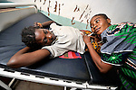 Pregnant Sheka Ehambi is examined by a nurse in the United Methodist hospital in the Congolese village of Tunda.