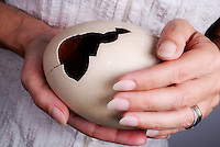 Woman holding broken ostrich egg