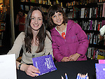 Megan Níc Dhonnchadha pictured with author Erike McGann when she signed copies of her new book 'The Demon Notebook' at Waterstones in Scotch Hall. Photo: Colin Bell/pressphotos.ie