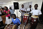 Haitian-Dominican musicians play during worship in an evangelical church in La Hoya, a small rural town near Barahona in the southwest of the Dominican Republic. The service brings together Dominicans and Haitian-Dominicans from a nearby batey in an unusual demonstration of unity in a land where discrimination against Dominicans of Haitian ancestry is growing.