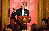 United States President Barack Obama holds a glass during a State Dinner honoring President XI Jinping of China prior to their exchanging toasts in the East Room of the White House in Washington, DC on Friday, September 25, 2015.<br /> Credit: Ron Sachs / CNP
