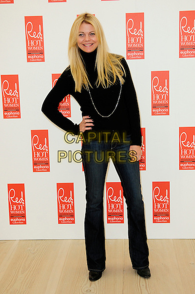 JEMMA KIDD .attends Red magazine's 'Red Hot Women Awards' at the Saatchi Gallery, London, England, UK, .November 30th 2010..full length black polo neck jumper sweater necklace jeans bootleg bootcut hand on hip .CAP/CAS.©Bob Cass/Capital Pictures.