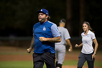 AZL Dodgers trainer Jesse Guffey rushes towards an injured player at third base during an Arizona League game against the AZL White Sox at Camelback Ranch on July 3, 2018 in Glendale, Arizona. The AZL Dodgers defeated the AZL White Sox by a score of 10-5. (Zachary Lucy/Four Seam Images)