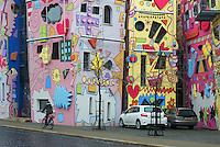 """Described as """"the happiest house on earth,"""" the Happy Rizzi House (Rizzihaus) in Brunswick is a day-glo masterpiece of cartoon-inspired architecture set smack in the heart of a staid German historic neighborhood.<br /> Standing in stark contrast to its old world surroundings, the Happy Rizzi House is the vision of New York pop artist James Rizzi (perhaps best known for designing the cover for Tom Tom Club's 1981 debut album) and architect Konrad Kloster. Representative of Rizzi's style, the structures are decorated in wild shapes and faces colored in bright pinks, yellows, and greens reminiscent of an 80's music video. Happy Rizzi House in Braunschweig. Das Happy Rizzi House (Eigenschreibweise Happy RIZZI House; meist nur """"Rizzi-Haus"""" genannt) ist ein zeitgenössisches Gebäude in Braunschweig, das von dem US-amerikanischen Künstler James Rizzi (1950–2011) entworfen und vom Braunschweiger Architekten Konrad Kloster umgesetzt wurde. Es befindet sich am Ackerhof.<br /> <br /> Es entstand auf Initiative eines Braunschweiger Galeristen. Die Idee zum Rizzi-Haus entstand 1997. Der Grundstein wurde während des 26. Magnifestes, das vom 3. bis 5. September 1999 stattfand, durch den damaligen niedersächsischen Ministerpräsidenten Gerhard Glogowski gelegt. Nach zweijähriger Bauzeit war das aus neun verbundenen Teilbaukörpern bestehende Haus fertiggestellt."""