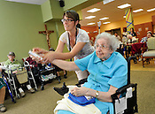 Sr. Matthew Cannizzaro, of the School Sisters of Notre Dame, is helped by Kim Karshna, who works at the St. Francis of Assisi motherhouse, on her Wii bowling form. Sisters from St. Francis of Assisi hosted the School Sisters of Notre Dame for a Wii bowling tournament on Thursday, June 16, 2011. Ernie Mastroianni photo.